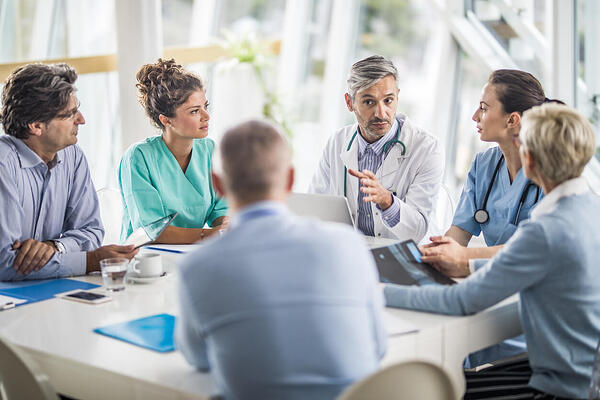 Doctor having a meeting with healthcare staff at medical practice