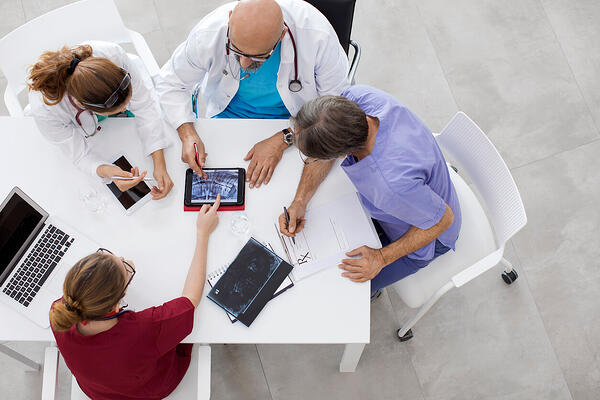 top radiology information systems doctors talking at table
