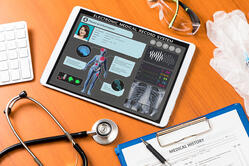 radiology information systems on a tablet showing patient infromation